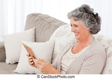 Woman looking at a photo