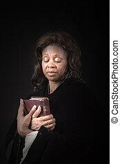 Woman Looking at Bible
