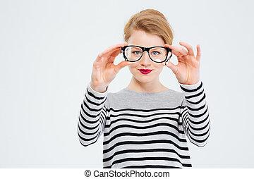 Woman looking at camera through glasses