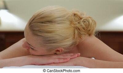 Woman looking at camera while massage