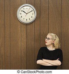 Woman looking at clock.