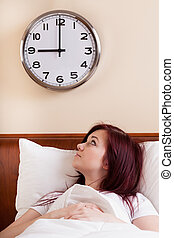 Woman looking at clock