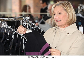 Woman looking at clothes in a shop