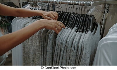 Woman looking at clothes in clothes store