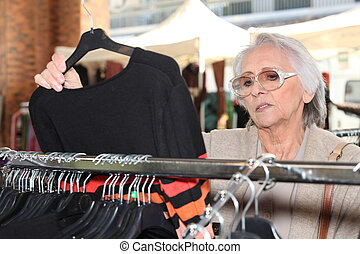 Woman looking at clothes on a rail