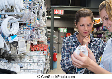 Woman looking at electrical cable in store