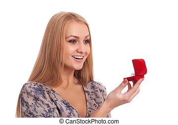 Woman looking at engagement ring in a box