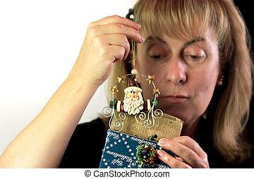 Woman Looking at Gift