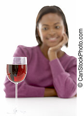 Woman Looking At Glass Of Wine