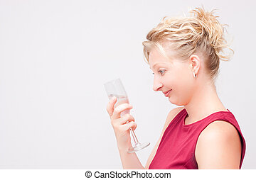 Woman looking at glass