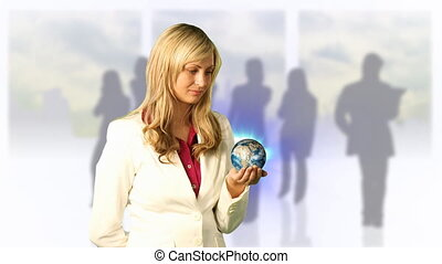 Woman looking at globe - Young businesswoman looking at ...