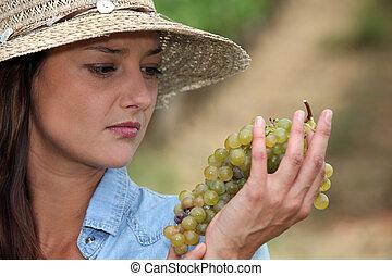 Woman looking at grapes