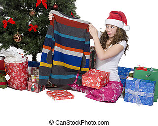 woman looking at her christmas present and making a face