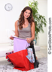 Woman looking at her fashion purchases