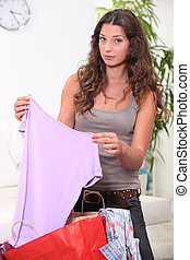 Woman looking at her shopping at home