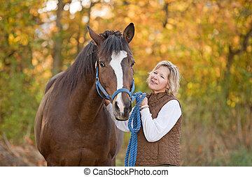 Woman Looking at Horse