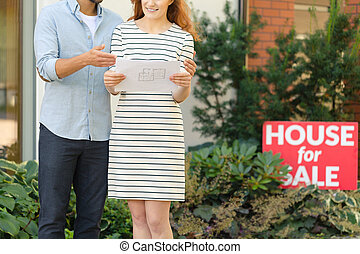 Woman looking at house plan