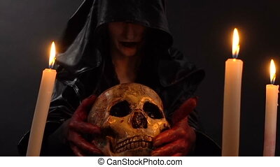Woman looking at human skull - Footage of woman during...