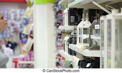 Woman looking at outdoor decorative lantern in the shop