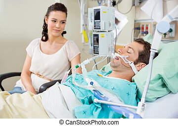 Woman Looking At Patient Resting - Woman looking at young...