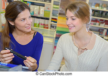 Woman looking at pen in store