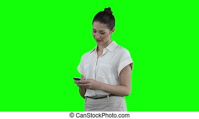 Woman looking at phone before looking at the camera