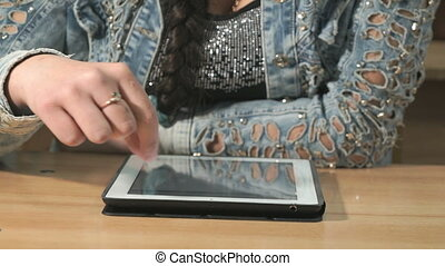 Woman looking at photos using computer tablet