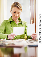 woman looking at photos - woman looking at pictures. Copy ...