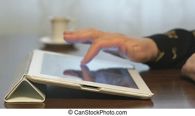 Woman looking at pictures on digital tablet
