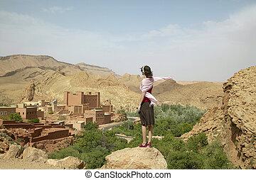 Woman Looking at Ruins