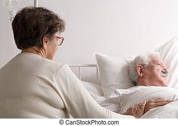 Woman looking at sick husband