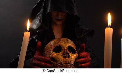 Woman looking at skull - Footage of woman during ritual on...