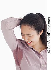 Woman looking at sweat patches - Distressed woman looking at...