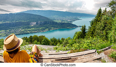 woman looking at the landscape of Lake Annecy