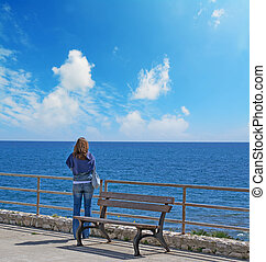 woman looking at the sea in autumn