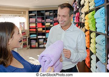 Woman looking at towels