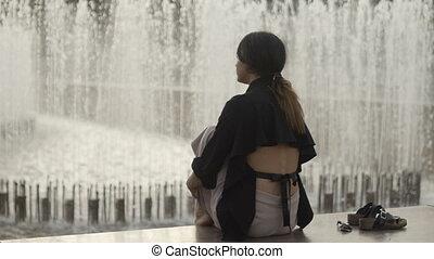 Woman looking at water - Unrecognizable elegant woman...