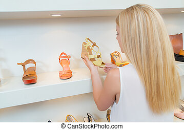 woman looking at wedge