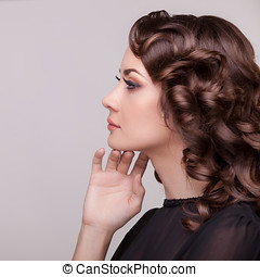 Woman looking away on a grey background