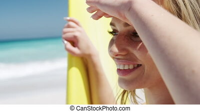 Woman looking away on the beach - Side view close up of a ...