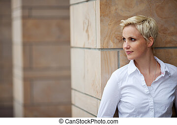 Woman Looking Away While Leaning On Pillar