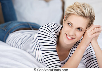 Woman Looking Away While Lying On Bed