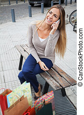 Woman Looking Away While On A Call - Attractive young woman...