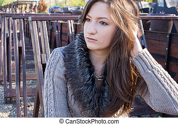 woman looking away while relaxing