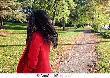 Woman looking back - Woman at the end of a road looking back