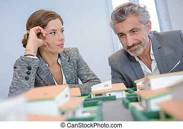 Woman looking contemptuously at housing developer