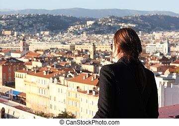 Woman looking down at the City of Nice
