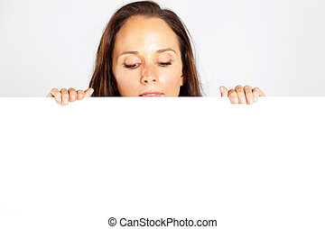 woman looking down at white board