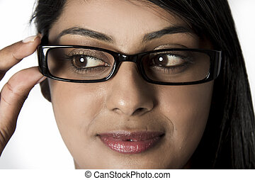 Woman looking down holding her framed glasses