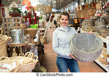 Woman looking for wickerwork in shop - Young woman looking ...